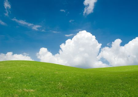 Rolling green hills under a blue summer sky. Stock Photo - 3461896