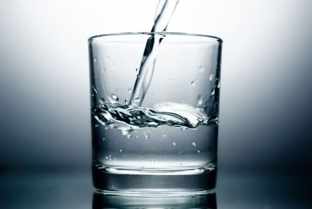 fluidity: Water pouring into a Glass.