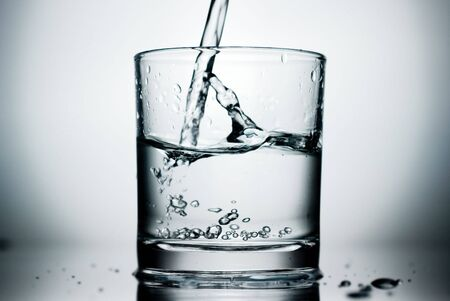 fluidity: Pure water pouring into a glass.