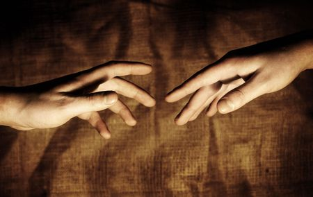Hands reaching out for each other. Stock Photo
