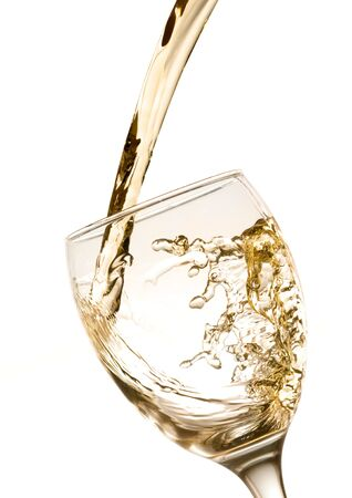 white wine: White wine being poured into a wine glass.