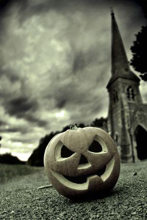 jackolantern: Halloween image with a Jack-O-lantern in a graveyard. Stock Photo