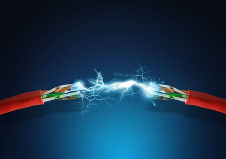conduction: High voltage spark between two cables. Stock Photo