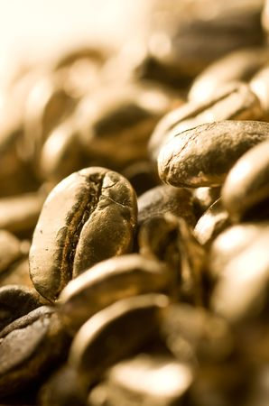 Macro image of gold coffee beans photo