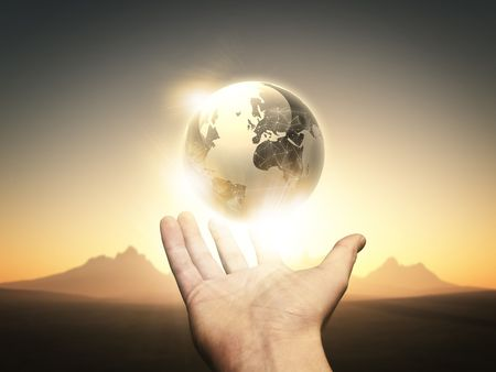 virtual world: A man holding the world in his hand.