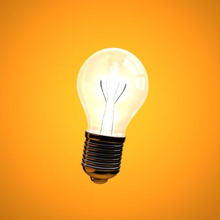 A 3D lightbulb on an orange background. photo