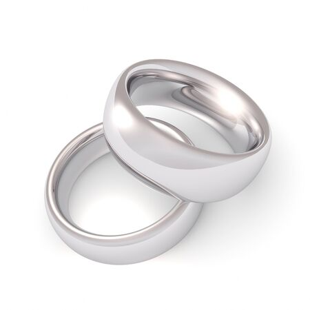 A his and hers set of platinum wedding bands. photo