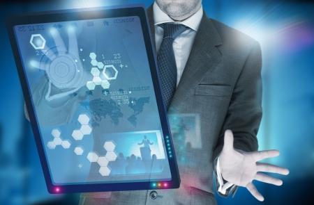 A businessman using modern technology. Stock Photo - 7508928