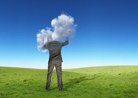 A businessman with his head in the clouds. Stock Photo - 7508927
