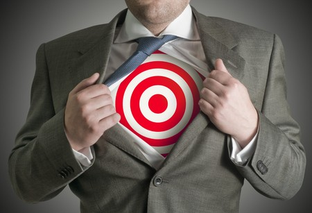 target business: A businessman pulling back his skirt to reveal a target symbol. Stock Photo