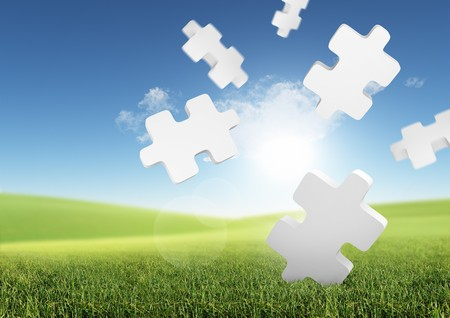 ploblem: Business Solutions. Conceptual image with falling puzzle pieces in a green field.