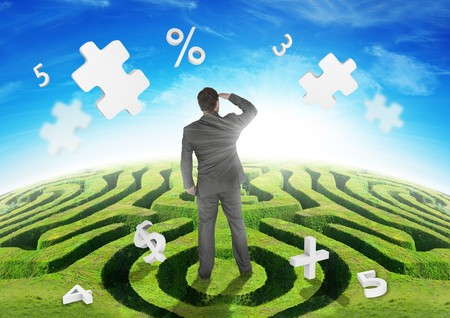 A Businessman on a maze, watching puzzles. Stock Photo - 8006136