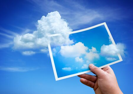 idea and concept: Clouds rising up from a picture.