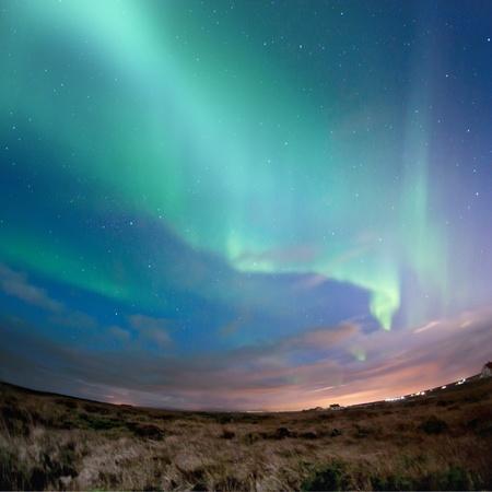 오로라: Aurora Borealis (Northern Lights) over southern Iceland. 스톡 사진
