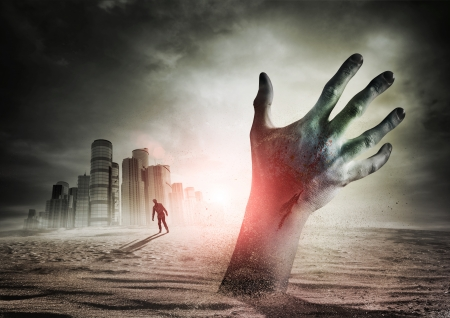 scary man: Zombie Rising. A hand rising from the ground!