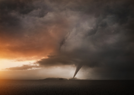 A Distant Tornado. A late evening storm producing a tornado. photo