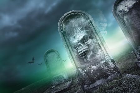 rising dead: Halloween Season, faces on a gravestone