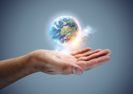 meaning: Your World -  The planet earth hovering in a hand