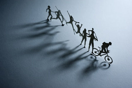 A Line of Paper People - Macro photography