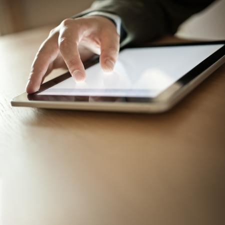 news background: Businessman Using Modern Touchscreen Device