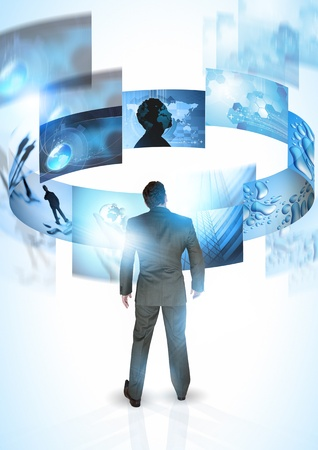vision future: Mind on Business - A businessman with rotating images Stock Photo