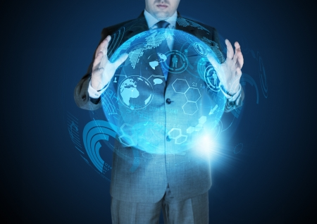 managing: Technological Advances - A businessman holding a technical globe. Stock Photo