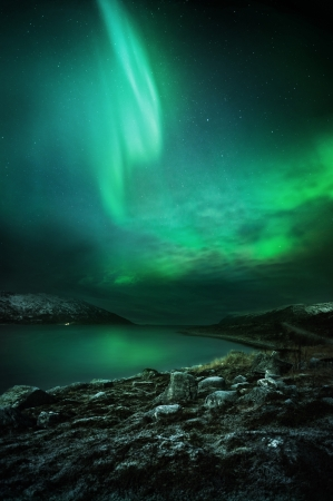 the aurora: The Northern Lights  aurora borealis  as seen from Northern Norway  Contains Noise  Stock Photo