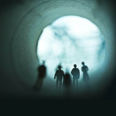 People walking through a tunnel in mist  photo