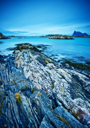 natureal: A coastal landscape, rugged rocks and blue sea.