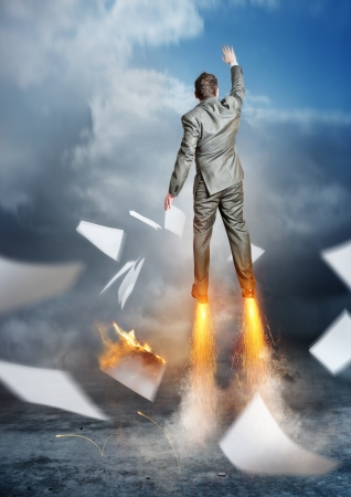 blast off: Business Accelerator  A businessman launching upwards  Stock Photo