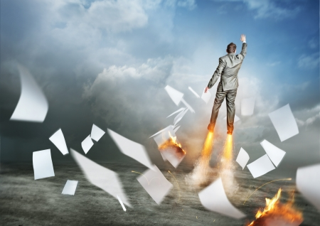 blast off: Businessman Success  A businessman launching upwards, paperwork flying everywhere