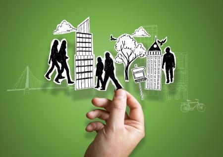 vida social: Una persona que tiene elementos de la ciudad de papel