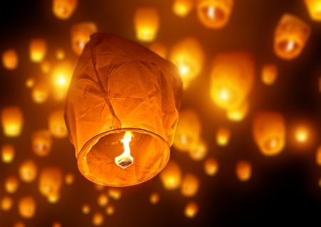 sky lantern: Make A Wish, A chinese lantern with lots more in the background Stock Photo