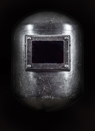 A welders Helmet front view, low key lighting. Stock Photo - 20697751