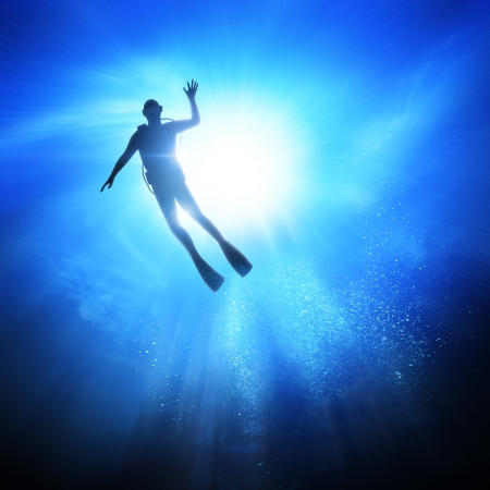 under water: Deep under the ocean, looking up towards a Diver.