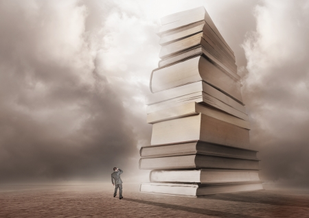 epic: A man looking forwards a mountain of books.