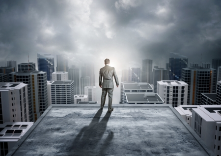 driven: A businessman watching over the city. Stock Photo