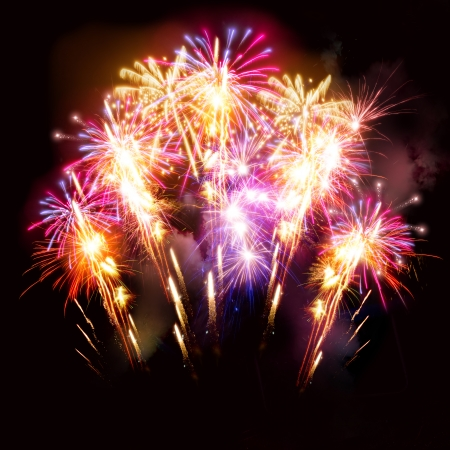 Colourful golden and pink fireworks display for celebrations. Stock Photo