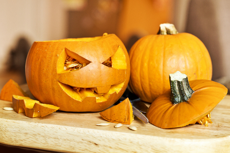 Carving up pumpkins into Jack O Lanterns for Halloween. Stock Photo