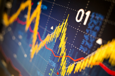 index: Stock market index graphs background. Stock Photo