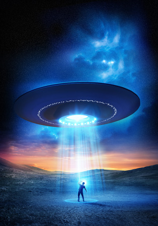 Out There. A man shields his eyes from the bright UFO above him. Abduction probable! Фото со стока