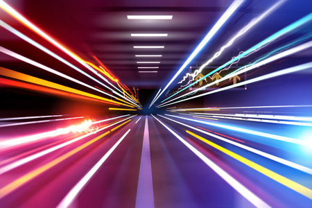 traffic light trails through an urban setting. Super fast! Stock Photo - 31060554