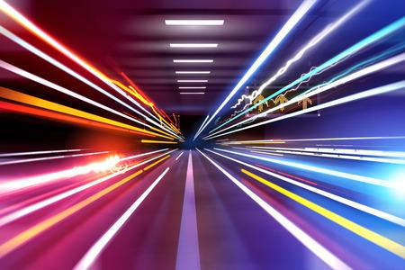 traffic light trails through an urban setting. Super fast! photo