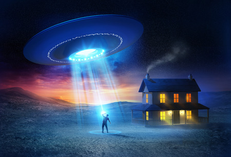 UFO Abduction. A person being abducted in front of his house one spooky evening. photo