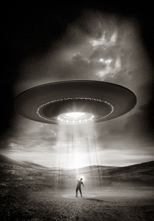 Out There. A man shields his eyes from the bright UFO above him. Abduction probable! Stock Photo