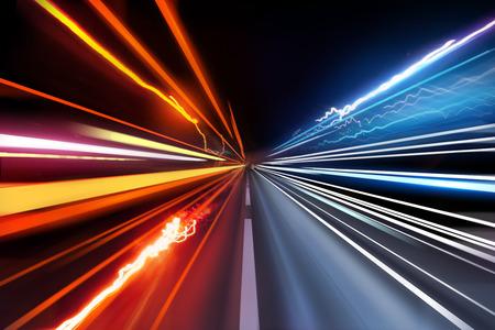 Fast moving traffic light trails at night.