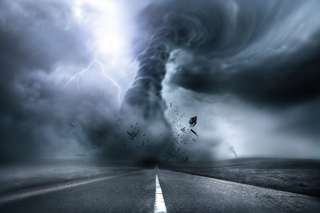 damages: A large storm producing a Tornado, causing destruction. Illustration.