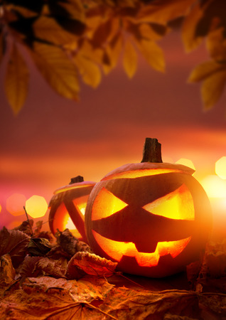 Halloween Jack-O-Lanterns, Glowing orange halloween carved pumpkins. photo