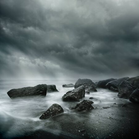 gust: Dramatic Coastal Scene. Sea Storm Long Exposure, Rugged coast line and swirling waters.