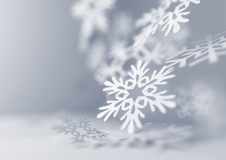 Falling Snowflakes. Paper craft snowflakes close up illustration of falling snowflakes. Christmas winter background. Stock Photo